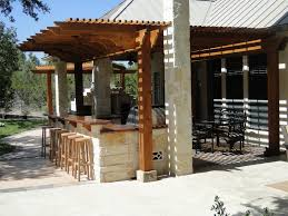 rustic outdoor kitchen designs with fireplace