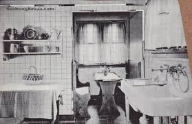 vintage 1920s kitchen in black and white i love the console sink