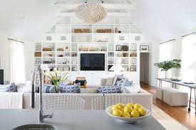 living room with vaulted ceiling and hanging lamp built in entertainment center v68 ceiling