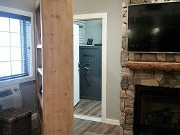 bookshelf doorway hides safe room by ultimate bunker