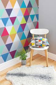 If you love geometric prints, you'll love this colourful wallpaper design.  It