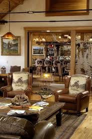 Image Awesome Rustic Western Ranch Home Love The Cowboy Chairs And The Antler Chandeliers Pinterest Rustic Western Ranch Home Love The Cowboy Chairs And The Antler