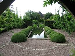 garden pond in formal garden surrounded by buxus
