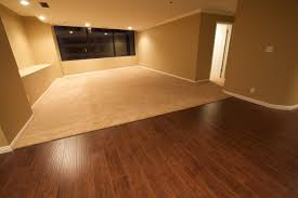 hardwood floor vs laminate with area rug together with brown painted wall