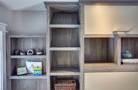 home office with murphy bed. Custom Cabinetry. Upper Detail Around Murphy Bed Home Office With