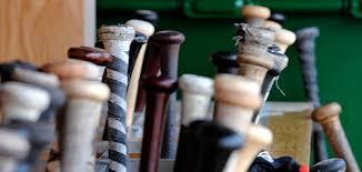 baseball bats in dugout