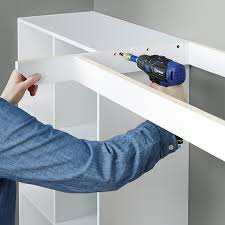 secure the desk frame to the cubes and back wall with s