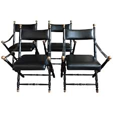 maison jansen chairs. four black leather campaign chairs in the style of maison jansen 1
