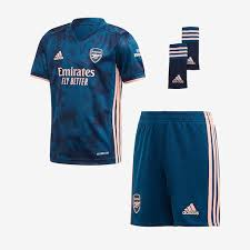 The blue home jersey features a herringbone pattern, as well as a dark blue round collar and sleeve trim. Adidas Arsenal 20 21 Third Mini Kit Legend Marine Light Flash Orange Boys Replica Tops Pro Direct Soccer