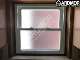 double hung vinyl window with frosted
