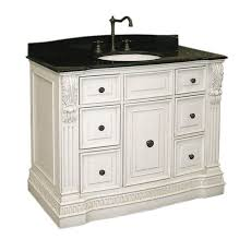 antique carved design white bathroom cabinet with black granite countertops