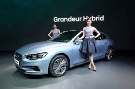 models pose with hyundai motor s grandeur hybrid vehicle during a a preview of the 2017 seoul