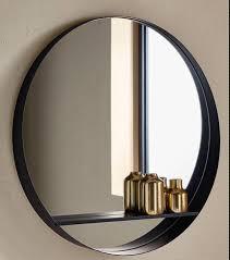black bathroom wall mirror with shelf