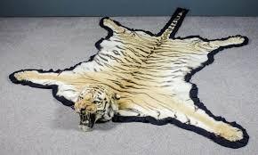 a good 1920 s indian tiger skin rug mounted by van ingen van ingen of mysore