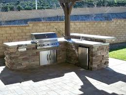 building outdoor fireplace with cinder blocks