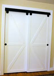 Faux Barn Door Remodelaholic How To Make Bypass Closet Doors Into Sliding Faux