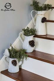 Decorative Pitchers Pine cones strung around rustic decorative pitchers Christmas 22