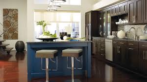dark wood cabinets. Delighful Cabinets Dark Wood Cabinets With A Blue Kitchen Island Inside