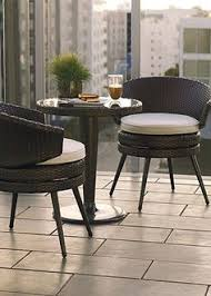 condo outdoor furniture dining table balcony. belize balcony seating frontgate for the dining patio would coordinate with style of amos swivel chairs on other side door wall condo outdoor furniture table