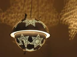 handmade lighting design. colanders with perforated star designs handmade lighting design