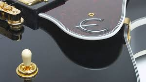 "epiphone b b king lucille lucille s rosewood fretboard has pearloid block inlays a classic epiphone sloped dovewing headstock and a gold metal truss rod cover engraved ""b b king """