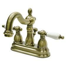 victorian porcelain lever 4 in centerset 2 handle bathroom faucet in antique brass