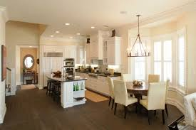 love the kitchen whose light fixture is over table for with decor 1