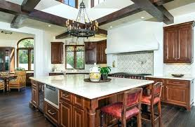 tuscan style kitchen beautiful with white marble counter and dark wood floors pendant lighting