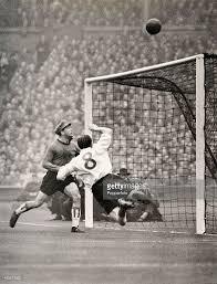 England inside-right Stan Mortensen in mid-air as he heads the ball...    England football team, England, Soccer art