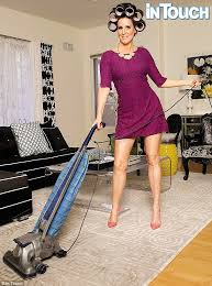 domestic dess the millionaire matchmaker vacuumed with rollers in her hair in the retro shoot