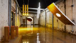 Designers Edge Farm Light In Good Company Installs Huge Lights In A D O Courtyard