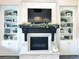 fireplace mantel is stained in ebony by duraseal but with brick and black and white tile