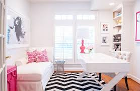 white and pink office with black and white chevron rug