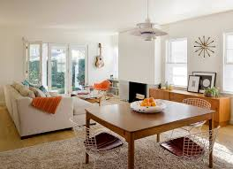 los angeles hanging guitar with rectangular area rugs living room contemporary and natural lighting glass doors