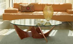contemporary round glass coffee table ideas features orange leather sofa and glass round coffee table