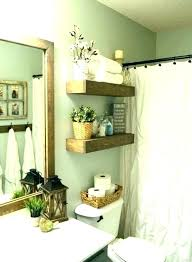 floating shelves above toilet bathroom behind shelf for behi