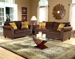 rug for brown leather couch area