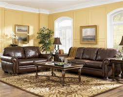 image of perfect living room color schemes with brown leather furniture