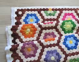Quick Quilting Tips - how to finish the edge of hexagon quilts ... & Then trim the edges like this, using a long ruler and rotary cutter. Simple  and easy – you have now straight edges. Adamdwight.com