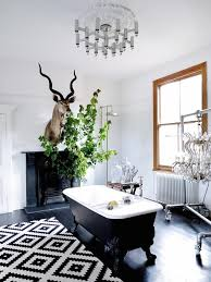 view in gallery an eclectic bathroom with a gorgeous black clawfoot tub