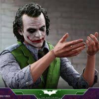 the special edition figure also includes a highly detailed grant dual face that captures the likeness of the joker with and without makeup
