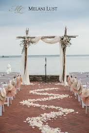 wedding arch white d plus mirrored flowers