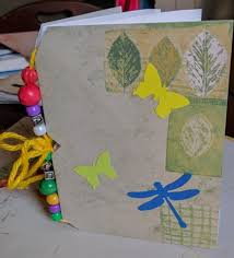 another envelope them repeating until the desired number of pages are achieved the whole book block gets wrapped in a long piece of decorative paper