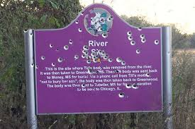 memorial of murdered teen emmett till vandalized by bullet  memorial set up to mark where emmett till s body was found vandalized bullet holes