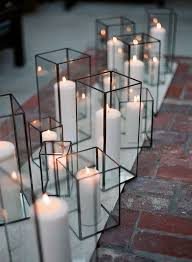 outdoor candle lighting. loving these modern simple candle holders outdoor lighting