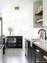 white and black kitchen cabinets with patterned tiles