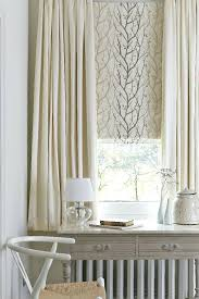 beautiful made to measure blinds and curtains layered together and in neutral colours create curtains for