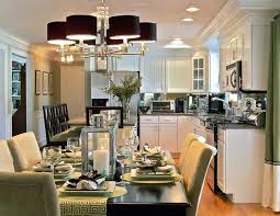 small kitchen open to dining room with best chandelier and recessed light above white cabinet also using lime green chairs around dark table sets