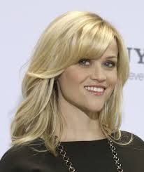 Layered Medium Length Hairstyles With Side Swept Bangs