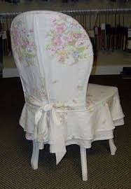 white washed wood and a linen fl with a double tier flounce skirt make the perfect bination for this chair